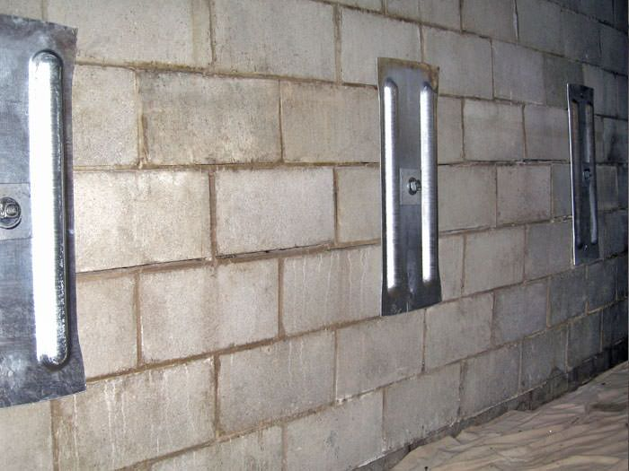 ... An Inside View Of Foundation Wall Anchors Installed Along A Basement  Wall To Brace And Repair ...